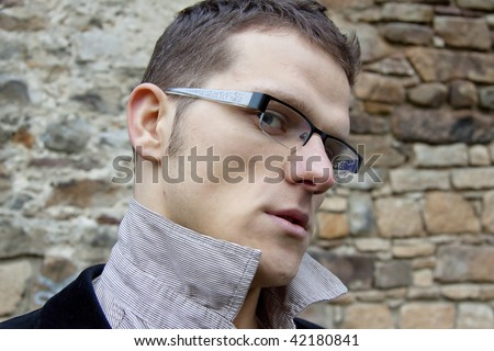 Angry face of young boss. - stock photo