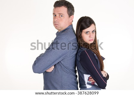 Angry father angry against his daughter isolated on white background - stock photo