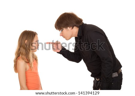 Angry father pointing the finger and explains what's wrong to her daughter. Isolated on white background. - stock photo