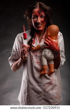 Angry female demon nurse with blood syringe and child. Horror concept. Book cover.