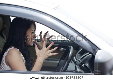 Angry female driver driving a car isolated on white - stock photo