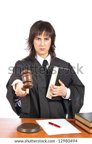 Angry female judge pointing at you in a courtroom. Eyes on focus and blurred gavel - stock photo