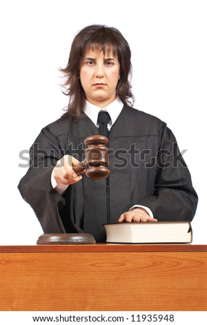 Angry female judge pointing at you in a courtroom. Focus on gavel and shallow depth of field - stock photo