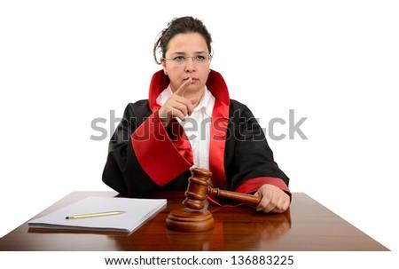 Angry female judge striking the gavel to keep silence isolated on white background - stock photo