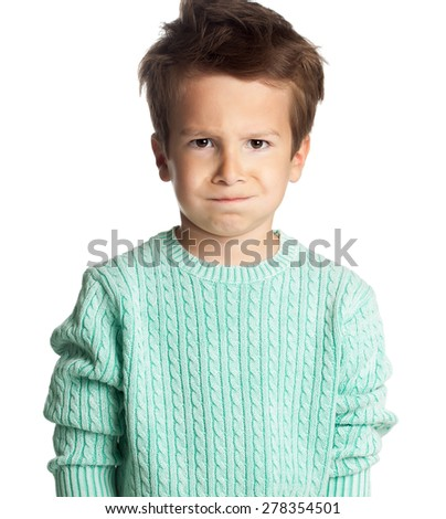 Angry five year old European boy posing over white studio background.  - stock photo