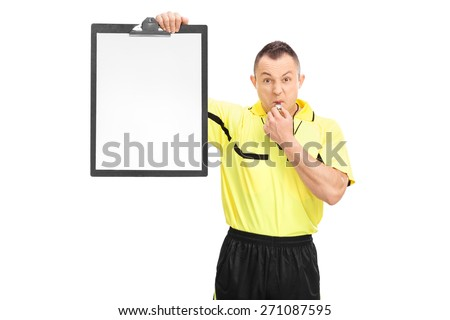 Angry football referee in a yellow shirt blowing a whistle and showing a blank paper on a clipboard isolated on white background - stock photo