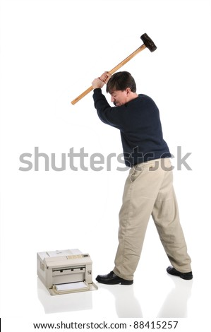 Angry, frustrated man swings sledge-hammer into printer isolated on white - stock photo