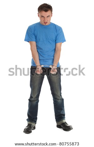 angry, furious young man with handcuffed hands - stock photo
