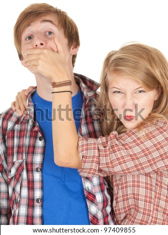 angry girl covering her surprised boyfriend mouth - stock photo