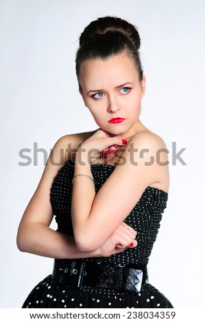 Angry girl in vintage dress - stock photo