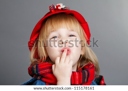 Angry girl making obscene hand gesture by showing middle finger - stock photo