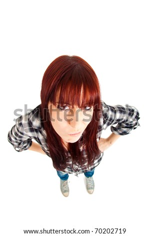 Angry girl shot with a wide angle lens isolated on white - stock photo