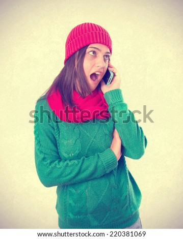 Angry girl talking by phone - stock photo