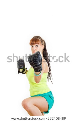 Angry girl wearing boxing gloves ready to fight and standing in combat position and trying to defend herself. Strength, power or competition concept image of beautiful young caucasian woman over white - stock photo