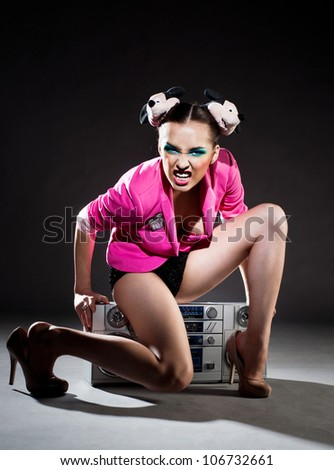 Angry girl with a tape recorder - stock photo