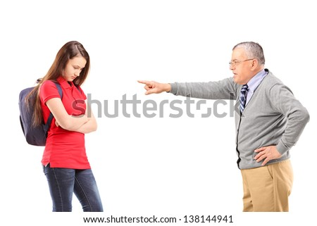 Angry grandfather shouting and pointing with his finger at his niece, isolated on white background - stock photo