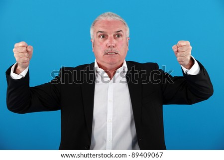 Angry grey-haired businessman