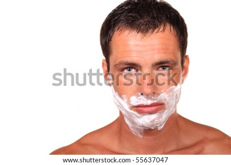 Angry handsome young man with a shaving foam - stock photo
