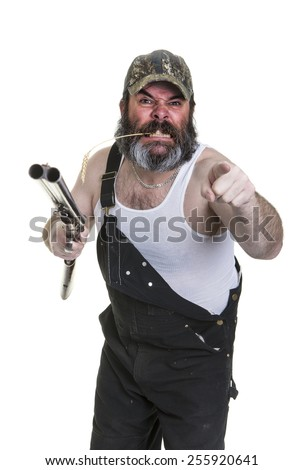 Angry hillbilly with shotgun on a white background. - stock photo