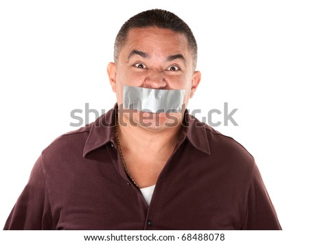 Angry Hispanic man with duct tape over his mouth - stock photo