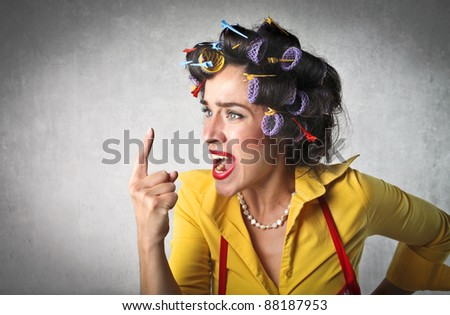 Angry housewife quarreling - stock photo