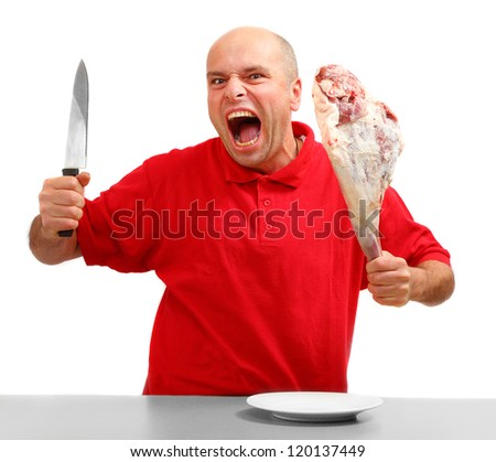 Angry hungry man (boss) with knife and raw bloody meat.  Downsizing metaphor. - stock photo