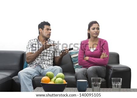 Angry Indian couple having an argument in their living room - stock photo