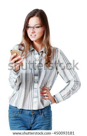 Angry irritated young business woman holding mobile phone wearing glases and shouting over white background - stock photo