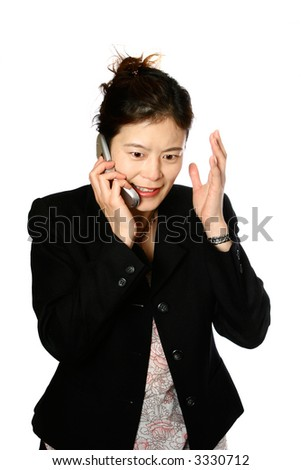 Angry Japanese businesswoman on the phone, showing facial horror, isolated on white. - stock photo