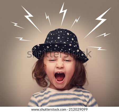 Angry kid in hat screaming with open mouth and white lightnings above on dark background - stock photo