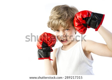 Angry kid in red boxing gloves - stock photo