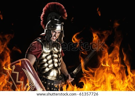 Angry legionary soldier in the fire