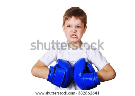 Angry little boy in blue boxing gloves,  on white background. Healthy lifestyle concept. - stock photo