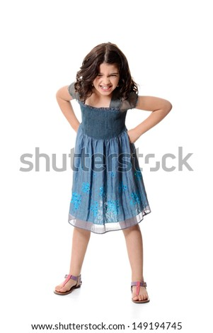 angry little girl in blue dress - stock photo