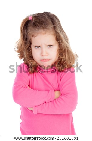 Angry little girl in pink isolated on a white background - stock photo