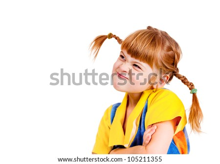Angry little girl with her arms crossed, looking up - stock photo
