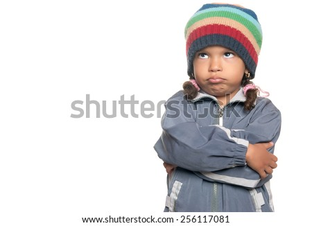 Angry little multiracial girl isolated on a white background - stock photo