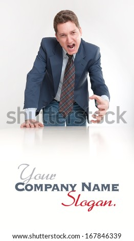Angry looking business man leaning on a table  - stock photo