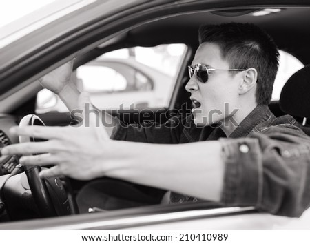 Angry male driver. - stock photo