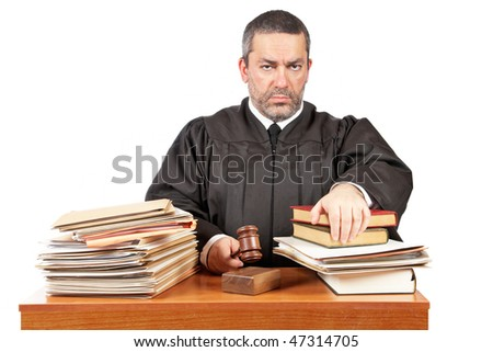 Angry male judge in a courtroom striking the gavel and pronounces sentence - stock photo