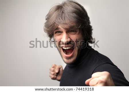 Angry man about to punch - stock photo