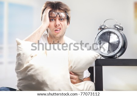 Angry man and clock - stock photo
