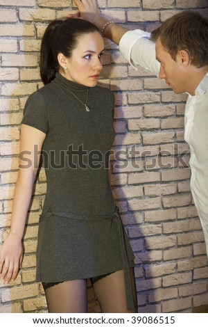 angry man and helpless woman - conflict situation between couple - stock photo