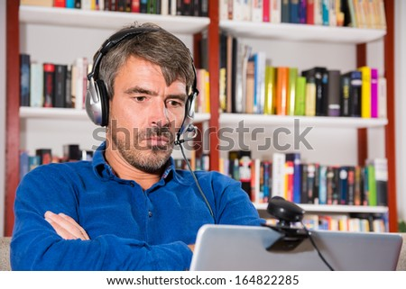 Angry man at video chat - stock photo