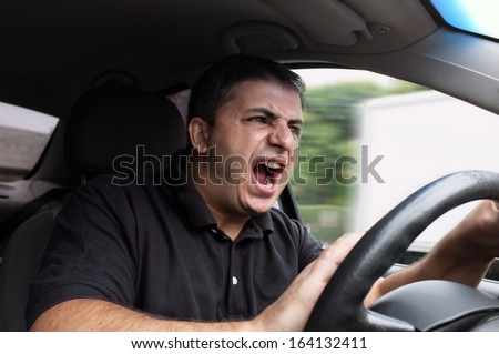 angry man driving a vehicle without seat belt  - stock photo
