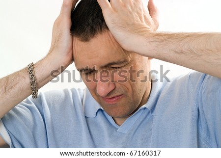 angry man in a blue shirt on a white - stock photo