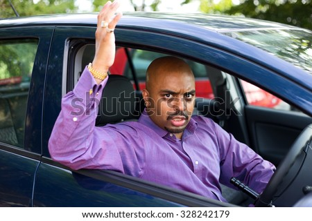 angry man in his car - stock photo