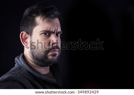 angry man on black background