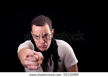 Angry man pointing - stock photo