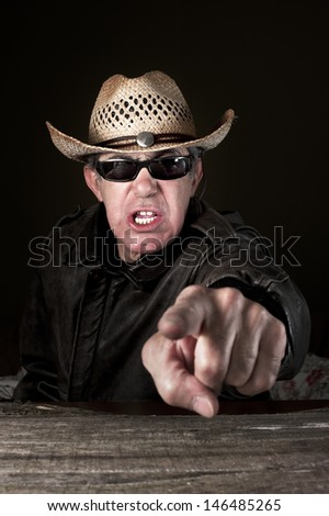 Angry man pointing and yelling Angry man with cowboy hat pointing with his finger and shouting - stock photo